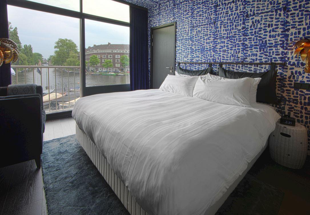 Design kamer met queensize bed